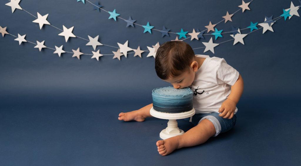 baby gift registry, cake smash chester, little boy eating beautiful blue cake