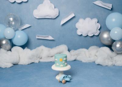 sky blue cake smash with paper planes